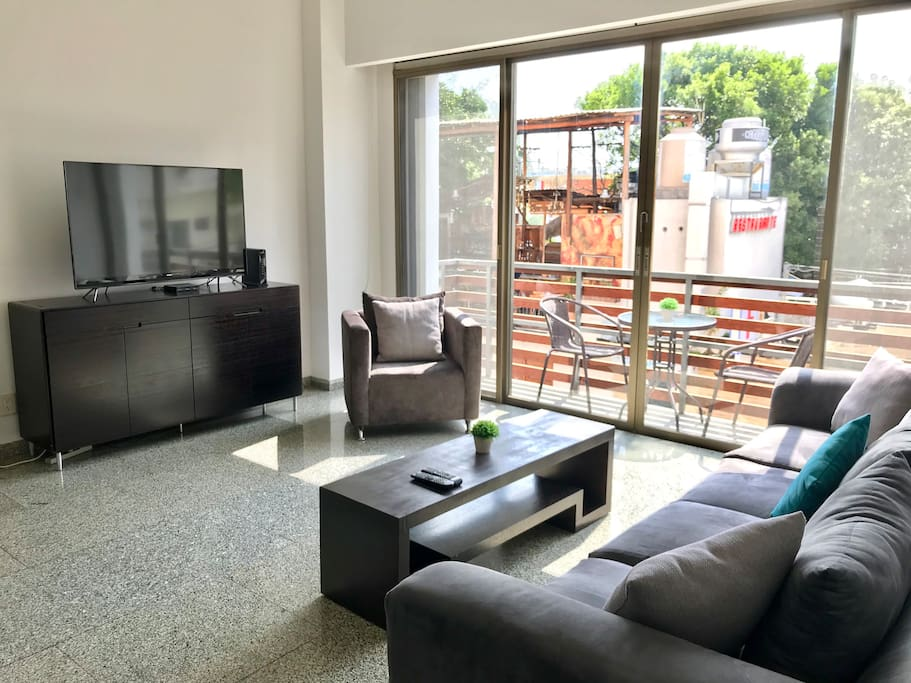 Bright living room with Smart TV and balcony