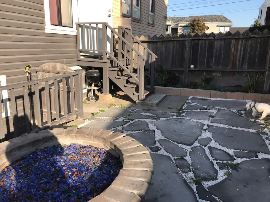 Updated backyard with garden and fire pit