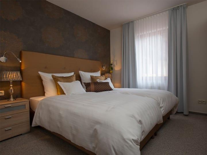 Hotel Hennemann, (Eslohe (Sauerland)), Exklusive Appartements mit getrenntem Wohn-Schlafraum und Balkon