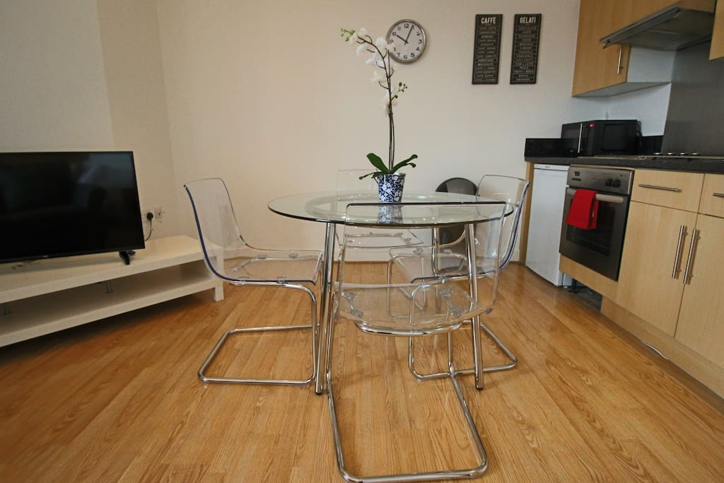 Glass dining table with four dining chairs
