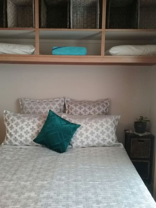 The turquoise room: Private room with thousand thread cotton sheets.