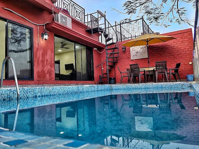Cozy 2BHK Bungalow in Mumbai with Private Pool.