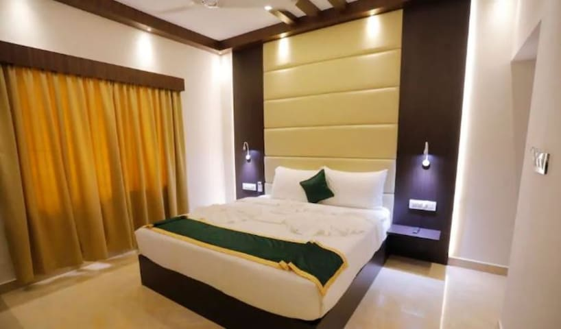 Deluxe room with complete range of modern amenities at Munnar Kerala