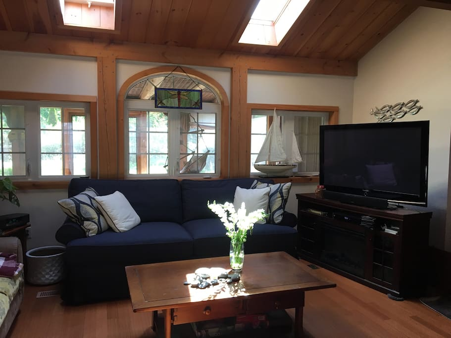 Spacious living room looks out to private fenced yard!