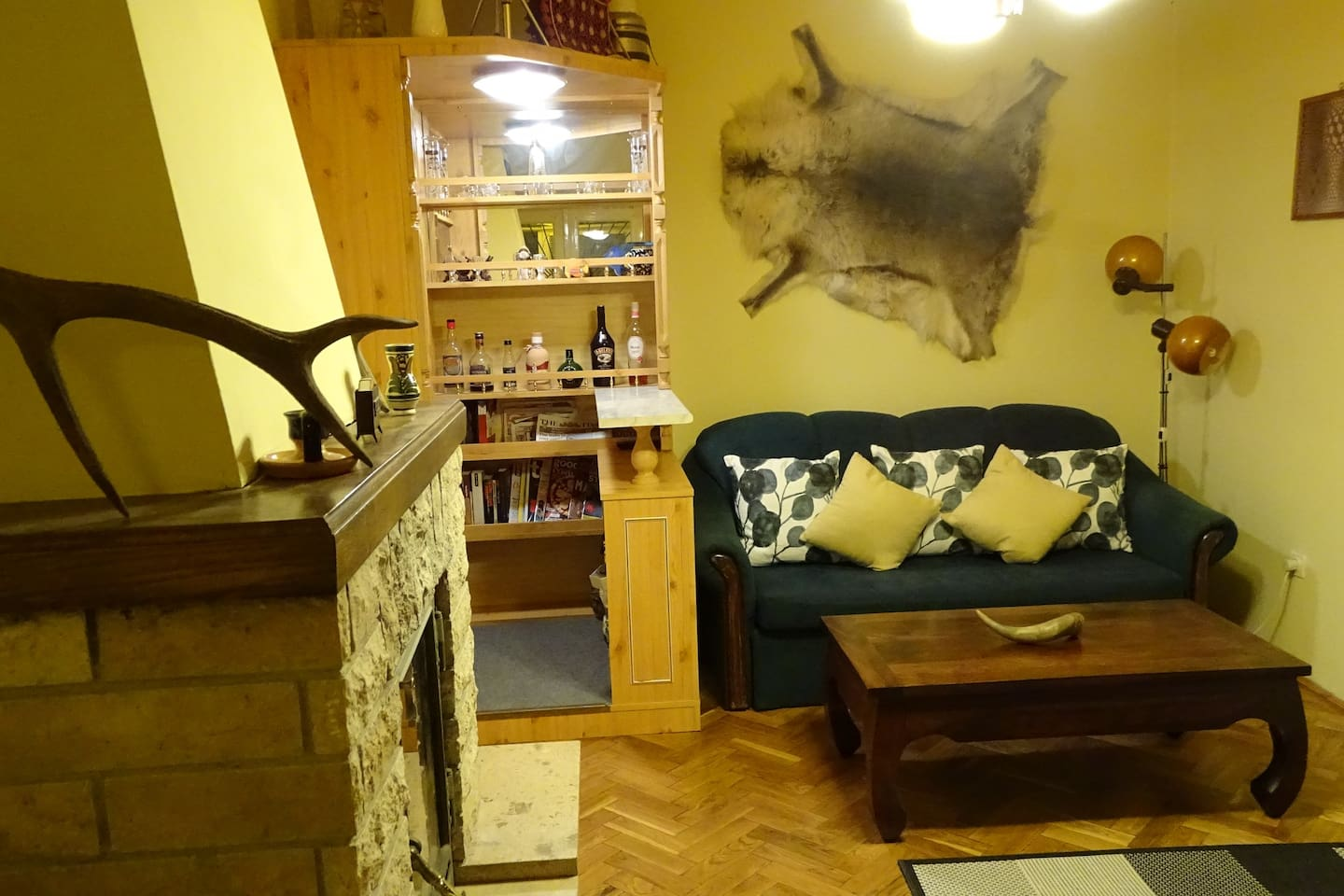 Fireplace, bar, couch