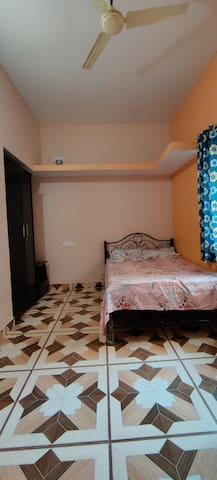 Master bed room with double bed, dressing table, wardrobes and attached bath/washroom