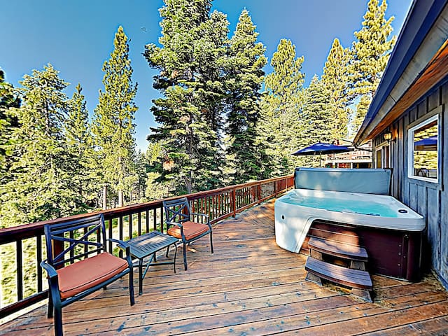 Soak in the hot tub with awesome views of the forest.
