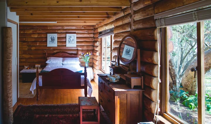 Luxurious double room in a timber log house.