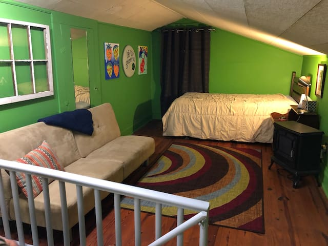 Upstairs Suite - Bed and couch