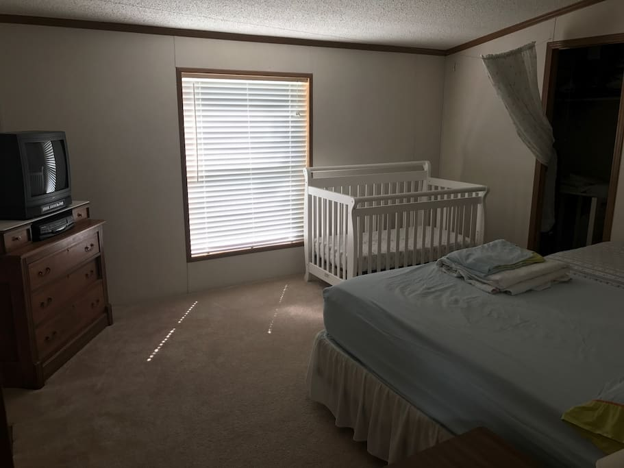 Bedroom #2 with crib and curtain to separate your child from seeing you