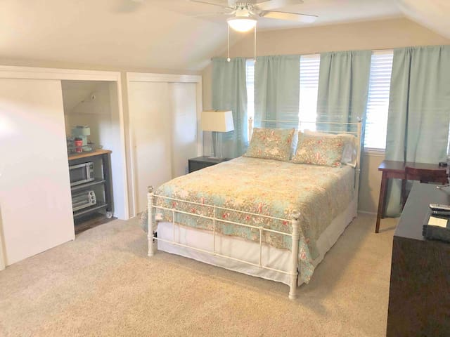 Spacious master bedroom with queen-sized bed and big closet space
