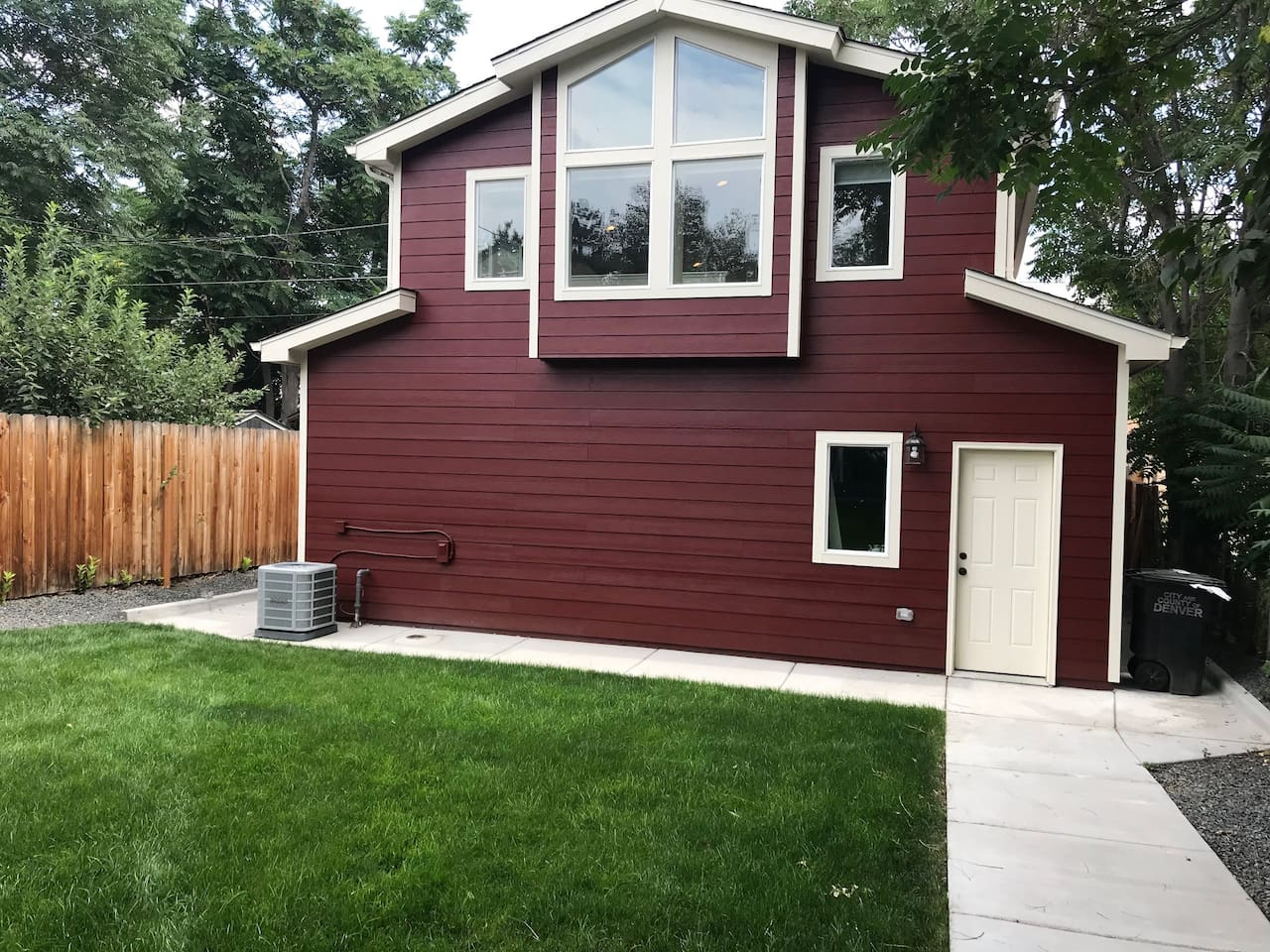 Shared yard with residence, and garage.