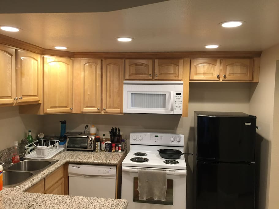 Kitchen with all appliances and plenty of countertop, bar