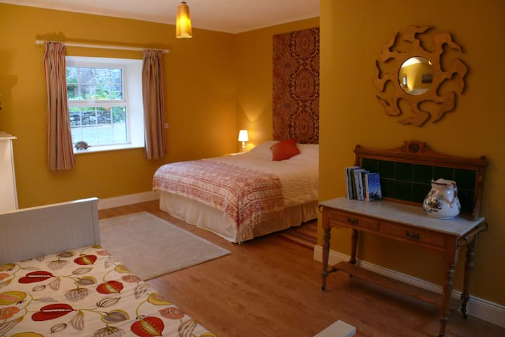 The large double bedroom with additional pull out double sofa bed