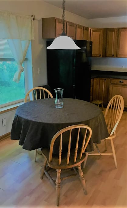 Dining area with large windows to watch the moose walk by!