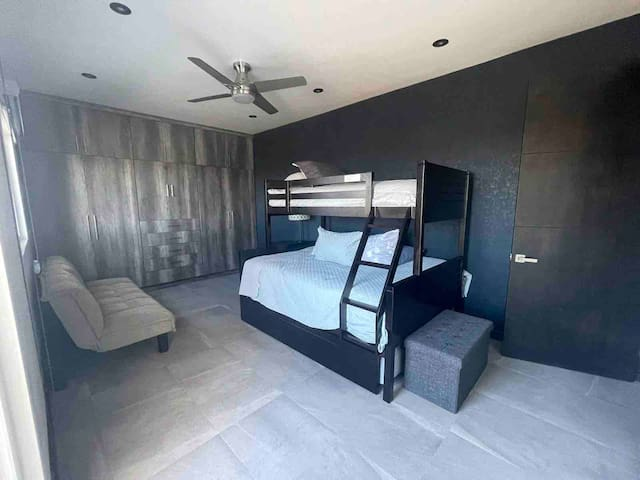 Bedroom 2, has a 3-bed bunk and balcony as well