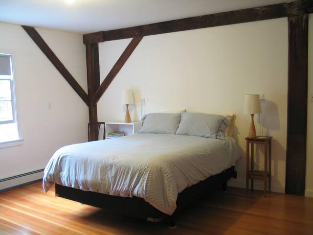 Master Bedroom with queen-sized bed, walk-in closet, dresser, and en-suite bath.