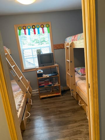 Pile the kids in this super functional bunk room. Lots of memories to be made in this room. 3 single beds and 1 double bed.