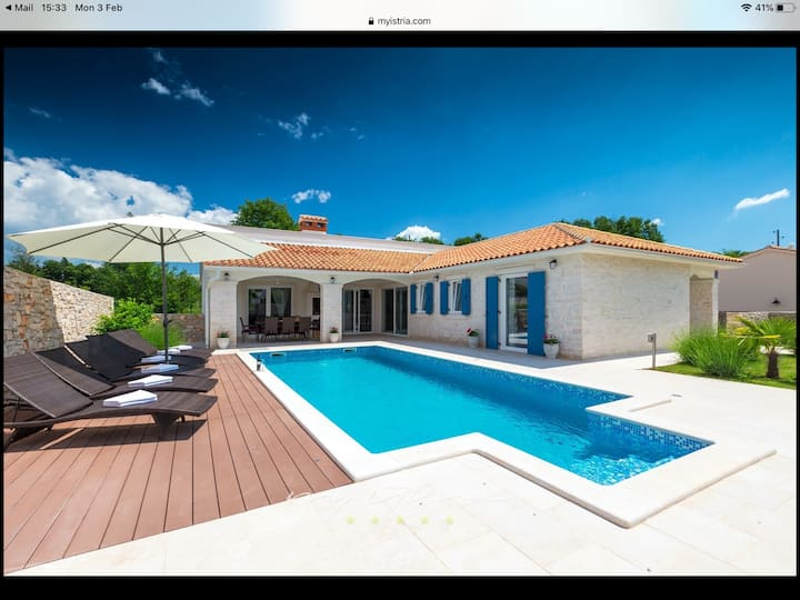 Villa with an outdoor heated swimming pool