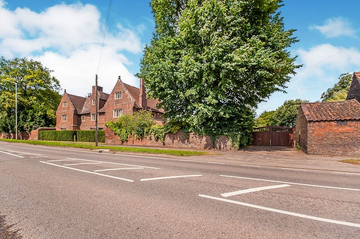 Half of our home has been  sectioned off to provide a private retreat. Ample car parking is available through our secure electric gates
