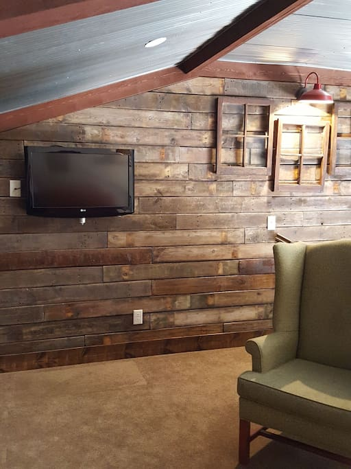 "The wall located up by the loft.  Also 32"" screen t.v."