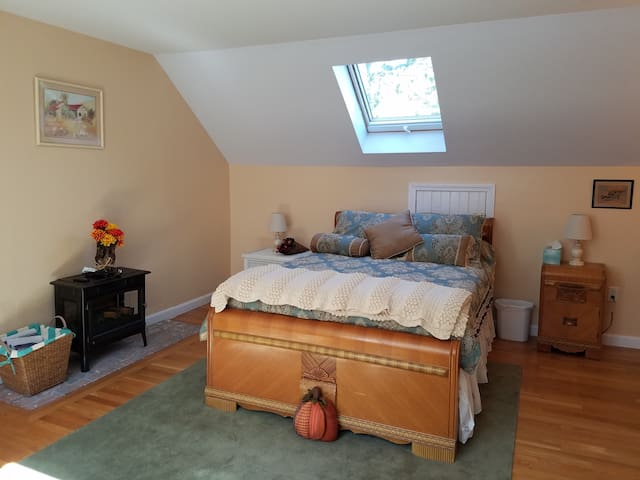 Enjoy your spacious 2nd floor bedroom with cozy electric Franklin stove.