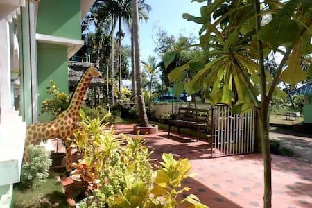 Green Garden Ayurvedic Resort - バルカラ - ゲストハウス