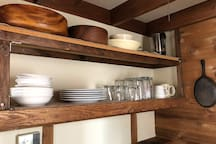 Open shelves with dishes and cups