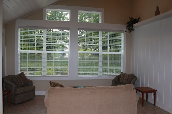 Sunroom adjacent to dining area