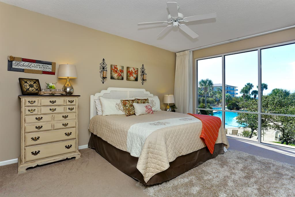 Master bedroom overlooking pool with beach view