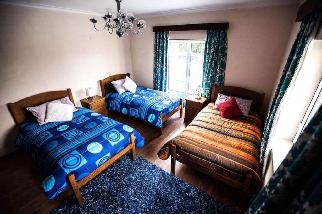 One of the two bedrooms which have 3 single beds