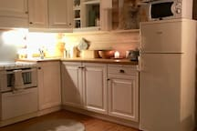 Fully equipped kitchen with dishwasher, stove, fridge, freezer and microwave.