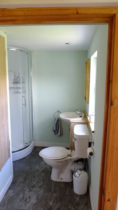 The shower-room also houses the washer & drier