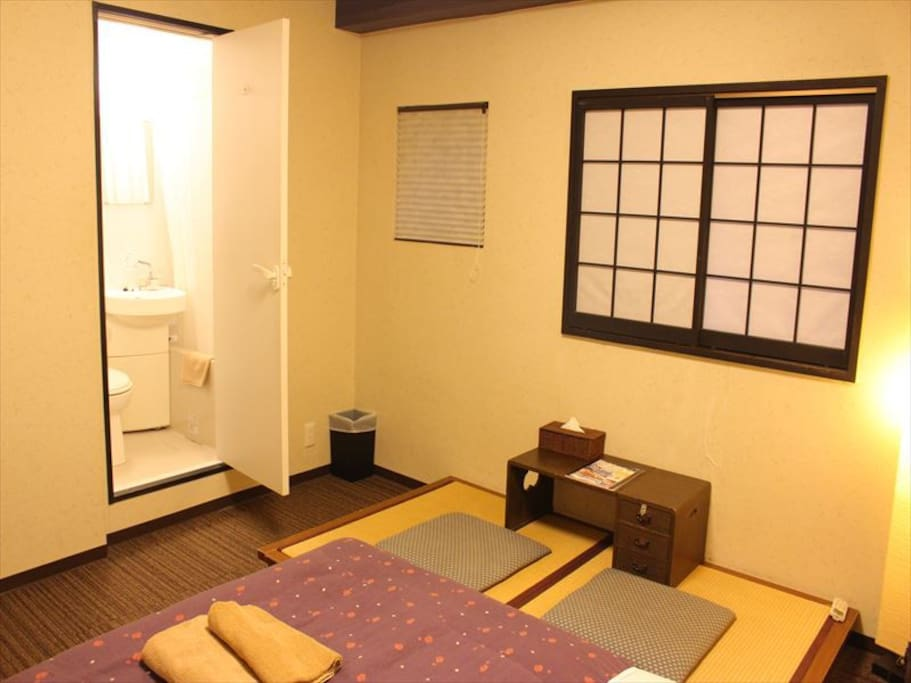 Room has a private bath and toilet.