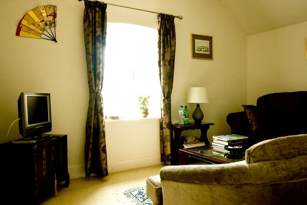 The private sitting room provides a comfortable haven in which to relax after a busy day. A full range of amenities is provided including Wi-Fi, TV/DVD, tea and coffee making facilities, juice, bottled water, a supply of sweets and biscuits and a mini fridge.