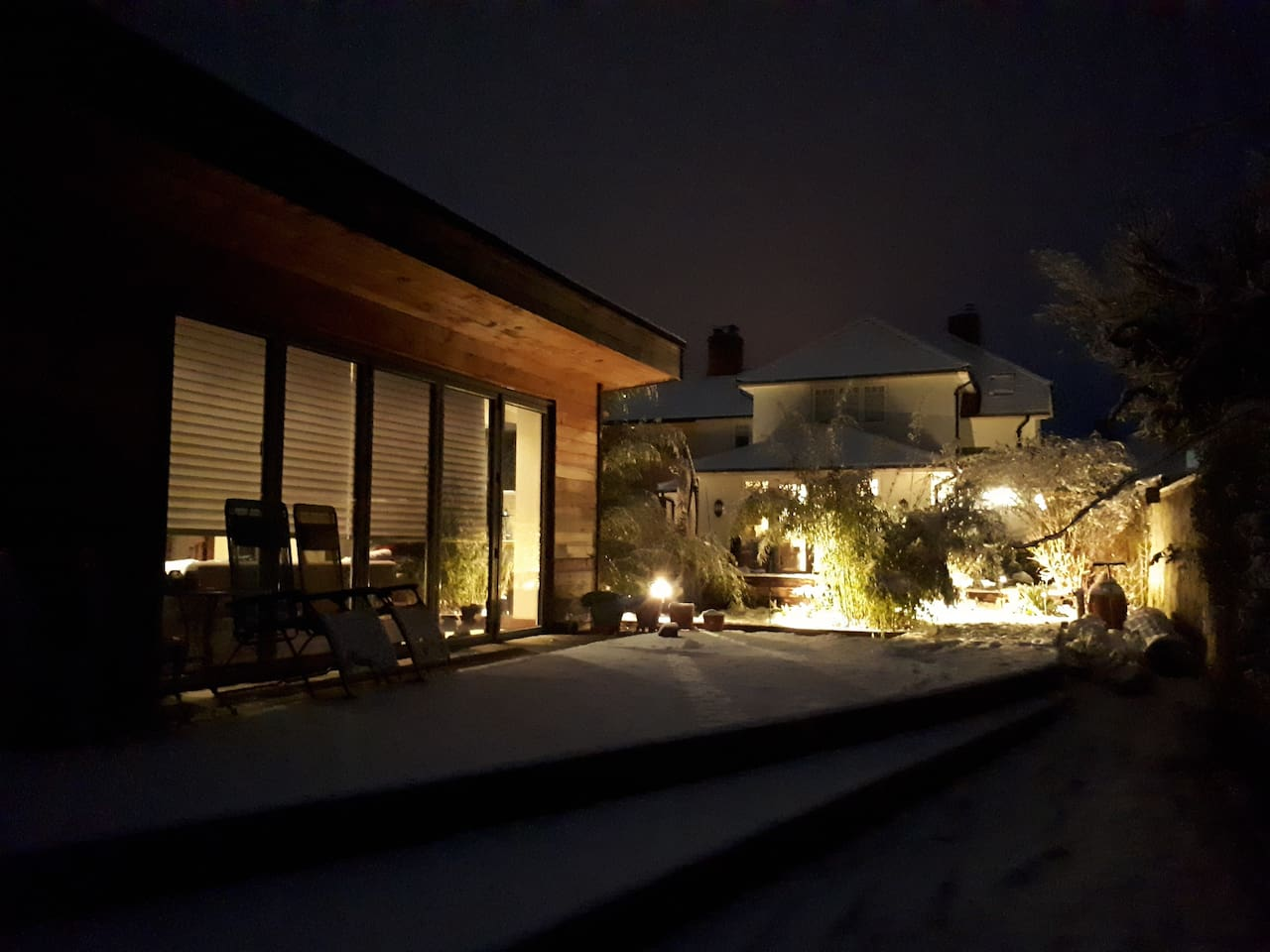 The Garden Room at night time when one of our guests are with us.