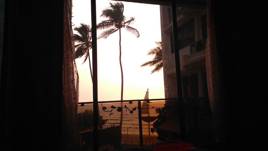 Private room in a flat  overlooking Juhu beach