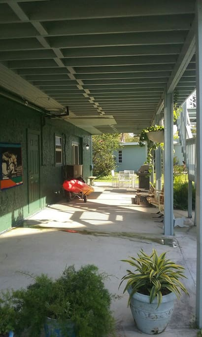 Entrance is to the right of the garage.