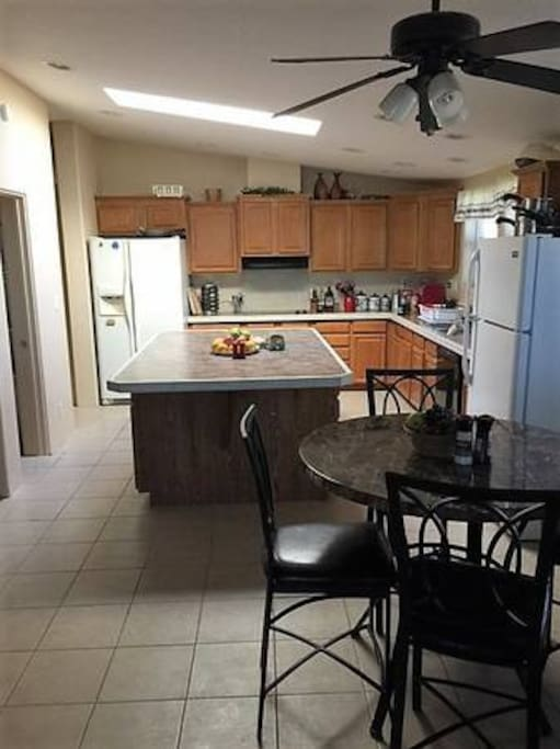 Shared kitchen space with two refrigerators