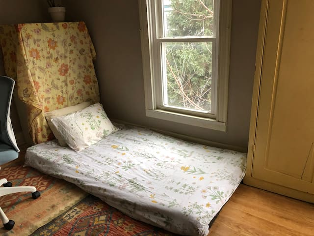 Enjoy the maple tree outside the window of the office and fold-up mattress.
