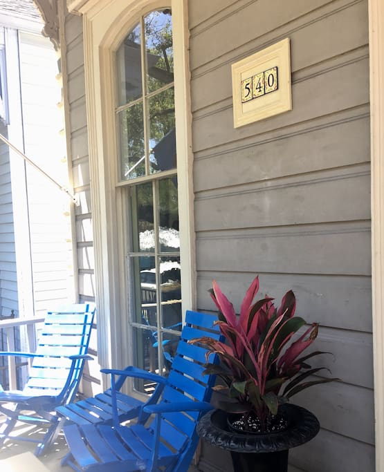 Enjoy our front porch shaded by the 300 year old Live Oak's