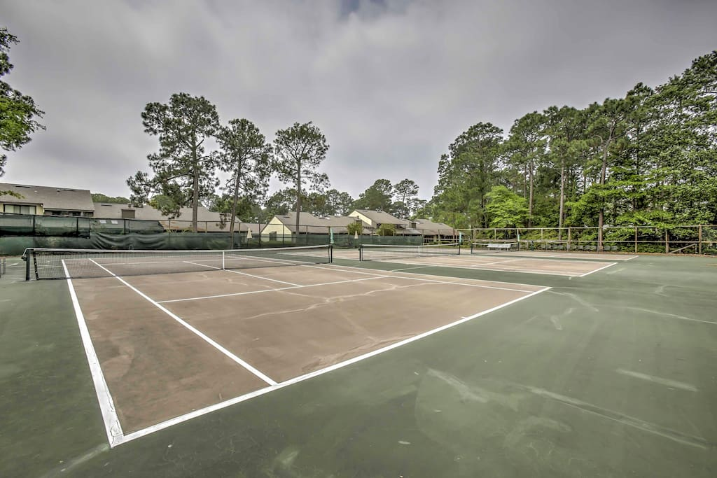 Challenge family to a game of tennis on one of 12 lighted clay courts.