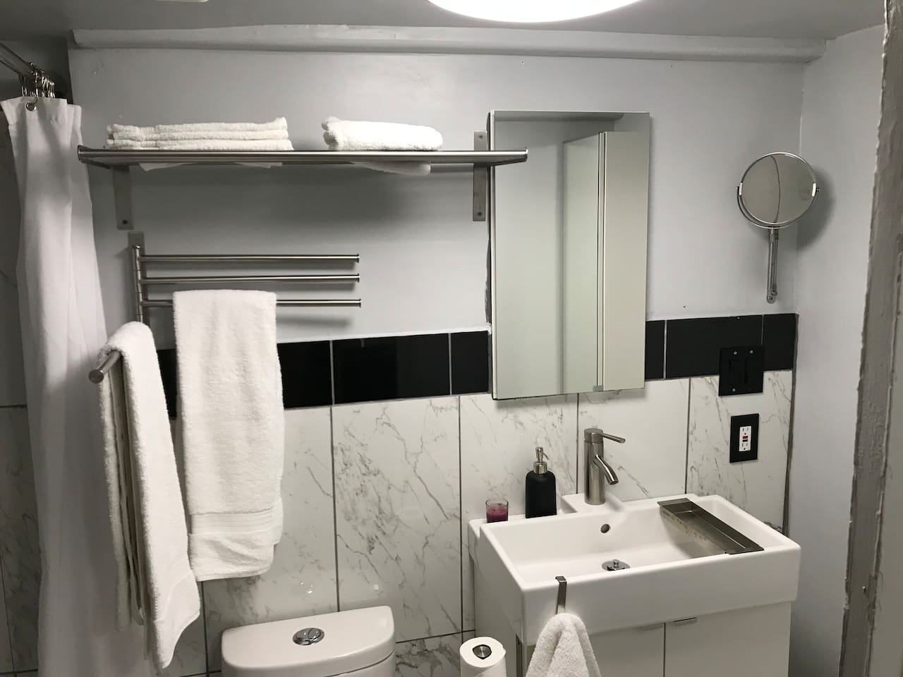 Large remodeled bathroom with plenty of mirrors and extra large shower.