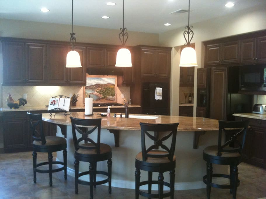 Huge kitchen with granite counter top and breakfast bar perfect for entertaining
