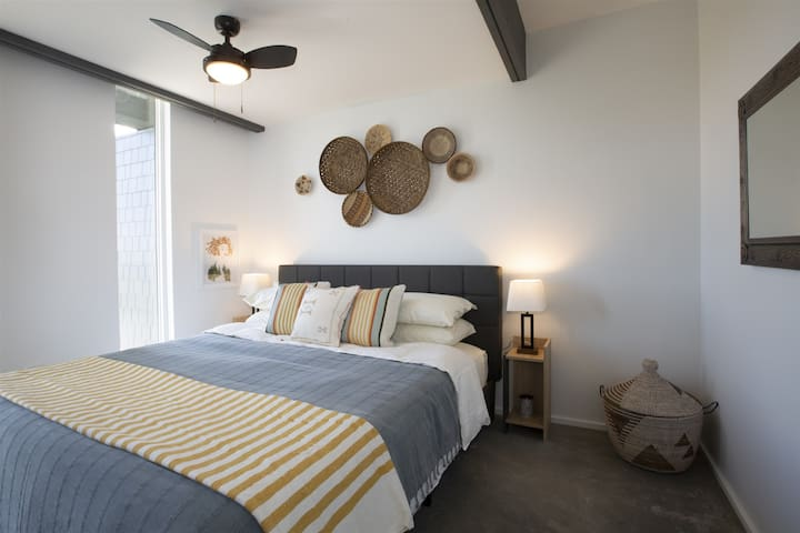 You'll sleep soundly in the king-sized bed with memory foam mattress. Bedroom windows have blackout roller shades for privacy.  All (super-soft) sheets and linens are included.