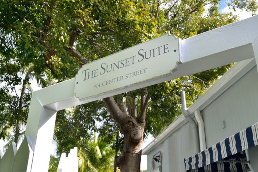 Sunset Suite, the sign over the gate to your private deck and entrance.  Gecko on the gate!