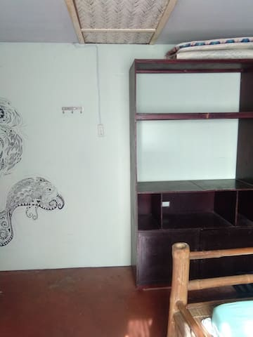 A simple storage for your stuff and a mini graffiti from one of our friends.