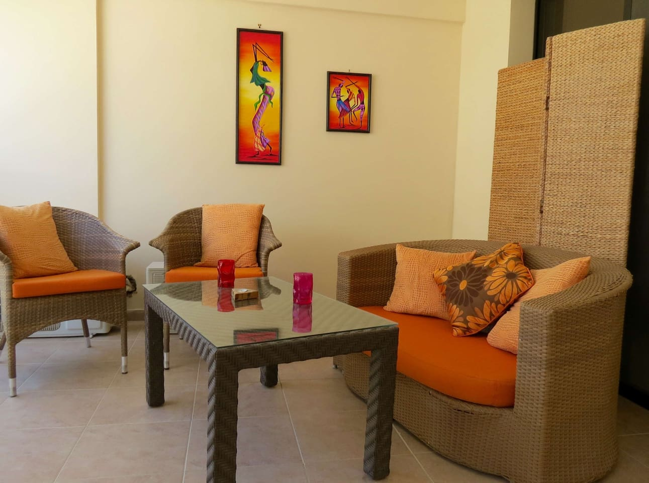 relax on the cool veranda overlooking the pool but with private seating area