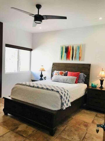 Bedroom #2 has a queen bed, ceiling fan