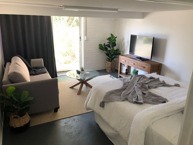 Newly renovated open plan bedroom which includes the lounge room. Wide glass sliding doors allow for plenty of natural light to enter the room. Thick block out curtains are fitted for your privacy.